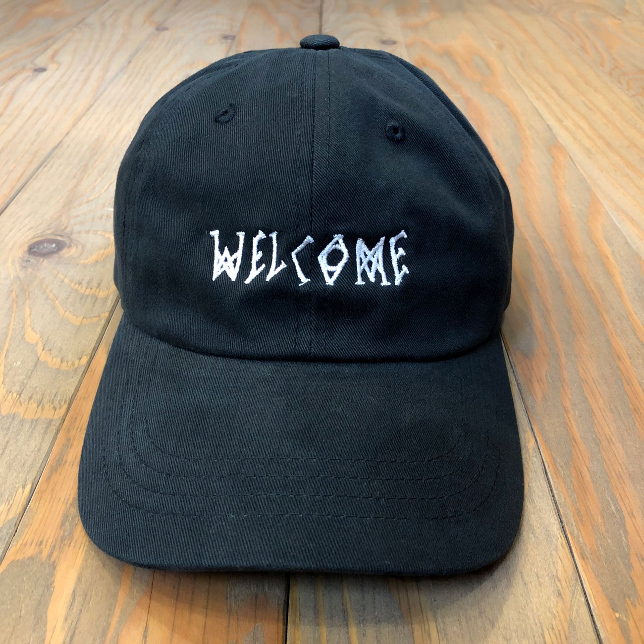 WELCOME SCRAWL PEACHED TWILL DAD HAT BLACK/WHITE