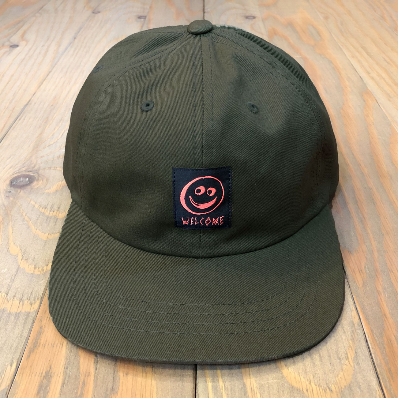 WELCOME SMILEY UNSTRUCTED SNAPBACK HAT OLIVE